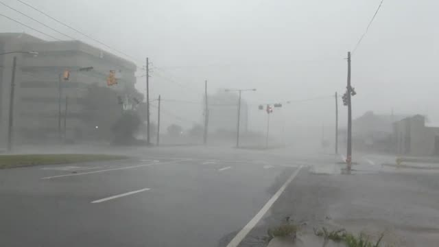Hurricane Isaac strikes a street in Gulfport, Mississippi.