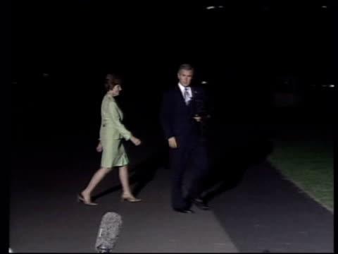 hurricane isabel hits east coast; ext/night us president george w bush & wife laura bush along - laura bush stock videos & royalty-free footage