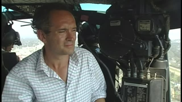 hurricane katrina 10 year anniversary file / august 2005 helicopter taking off reporter in helicopter ext air view aerial of flooded buildings int... - hurricane katrina stock videos and b-roll footage