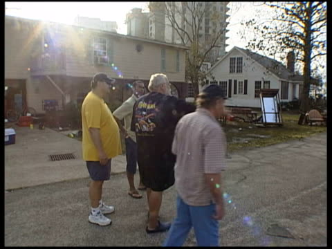 hurricane katrina aftermath 1: emergency shelter, destroyed buildings, flooded streets, refugees in houston; vox pops large man with beard, eddie,... - eddie large stock videos & royalty-free footage
