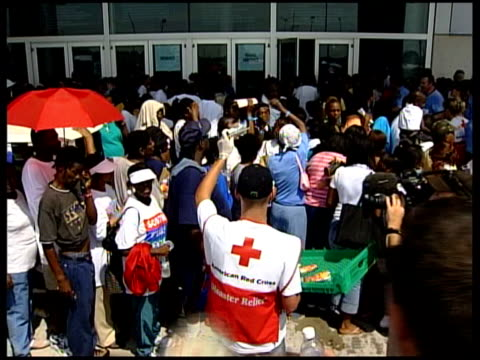 refugees in houston flooded areas army patrol new orleans skyline airviews more police organising crowds and policemen using megaphone louisiana new... - hurricane katrina stock videos and b-roll footage