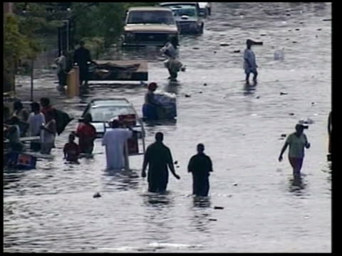 recriminations over response to disaster date louisiana new orleans ext survivors of hurricane katrina wading through floodwater int dead bodies... - hurricane katrina stock videos and b-roll footage