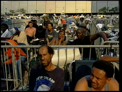 aid begins to arrive usa louisiana new orleans new orleans international airport int evacuees from hurrican katrian devastation lying on makeshift... - hurricane katrina stock videos and b-roll footage