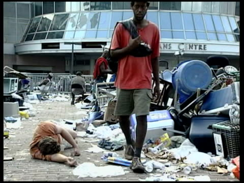 bush briefing revealed tx new orleans ext body laying on ground next debris - hurricane katrina stock videos and b-roll footage