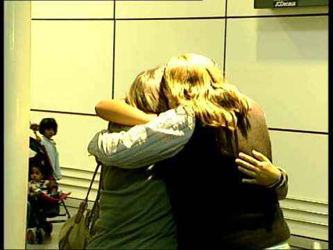 first britons return home england london gatwick airport int returning britons caught up in the hurricane katrina disaster in new orleans are met by... - hurricane katrina stock videos and b-roll footage