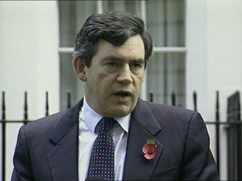 aid appeal; england: london: downing street: ext clare short mp from no.11 with gordon brown mp and up to press conference mics gordon brown mp press... - rebuilding stock videos & royalty-free footage