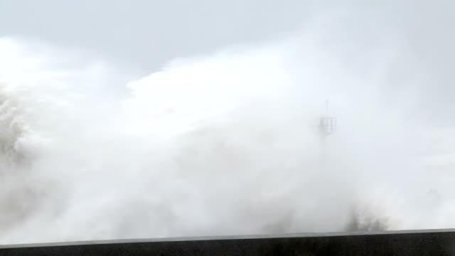 Hurricane Storm Surge Waves Crash Into Harbor