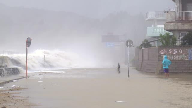 Hurricane Storm Surge Waves Crash Over Sea Wall