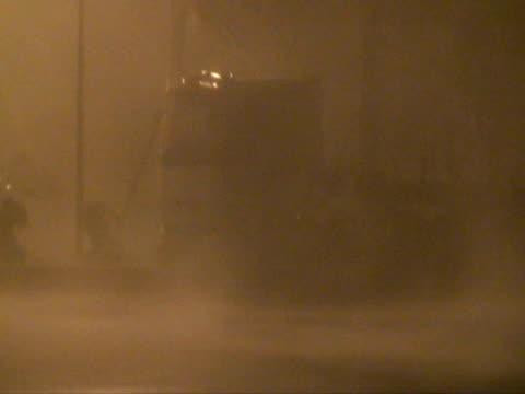 Hurricane winds lashing truck; Typhoon Sinlaku, Taiwan, 13th September 2008, medium shot. (With Audio)