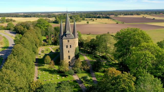vídeos de stock e filmes b-roll de husaby christian church in sweden aerial view - por volta do século 11 dc