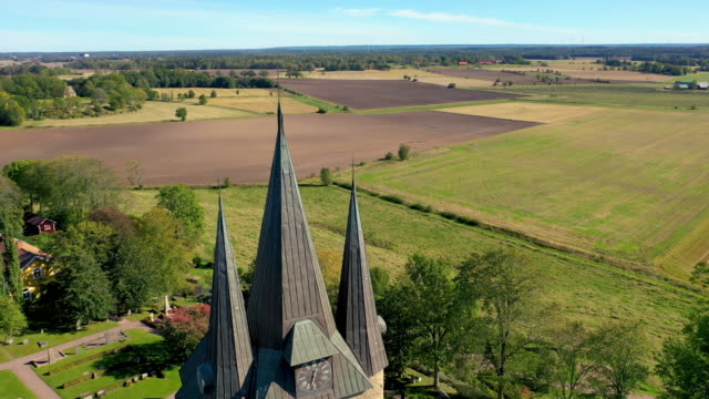 husaby church flyover reveal aerial - circa 11th century stock videos & royalty-free footage