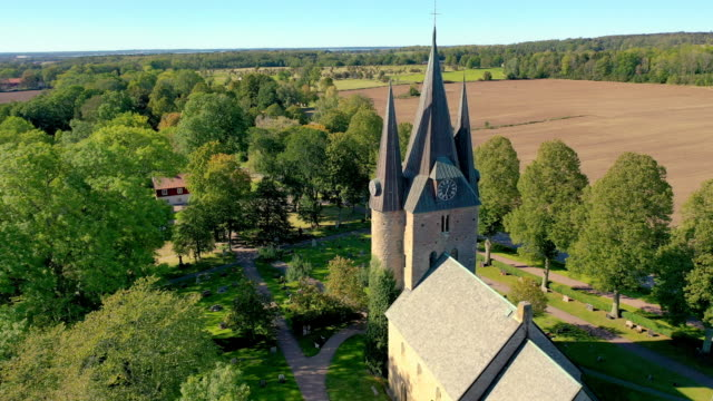 husaby church in sweden aerial - circa 11th century stock videos & royalty-free footage