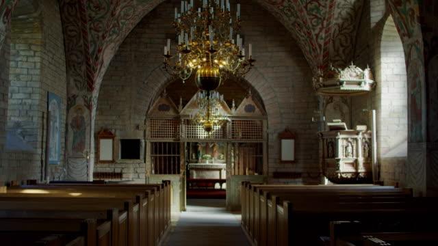vídeos de stock e filmes b-roll de husaby interior first christian church in sweden - por volta do século 11 dc