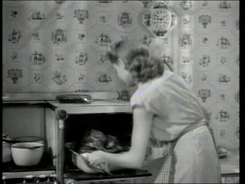 1947 MONTAGE Husband and wife about to eat Thanksgiving dinner
