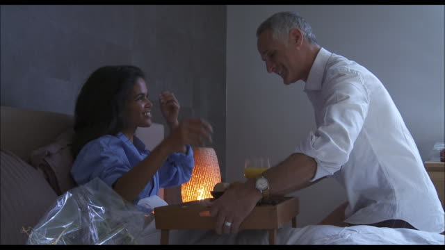 Husband and wife breakfast in bed