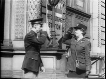 stockvideo's en b-roll-footage met husband and wife first lieutenant and mrs elmer miller, a waac officer walk towards camera, salute and part / close-up mrs miller seated in waac... - military recruit