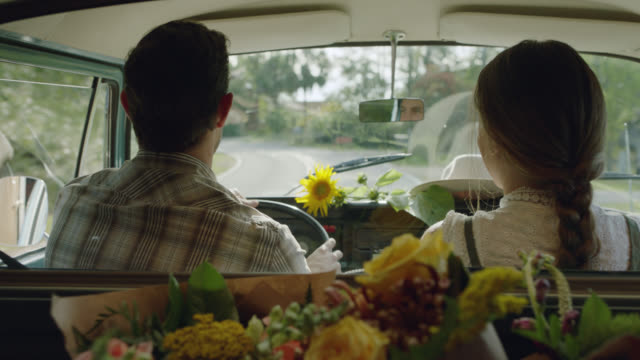 husband and wife florists delivery flowers in their mobile flower truck - real life stock videos & royalty-free footage