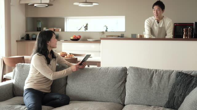husband and wife have a talk at home - only japanese stock videos & royalty-free footage
