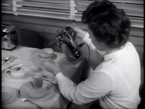 husband and wife having breakfast at the dining table / woman pours herself a cup of coffee from a coffeematic pot / montage of workers in a factory... - coffee pot stock videos & royalty-free footage