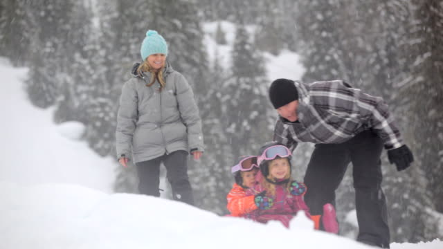 ms pan td husband and wife her two girls on a toboggan  / whistler, bc, canada   - pushing stock videos & royalty-free footage