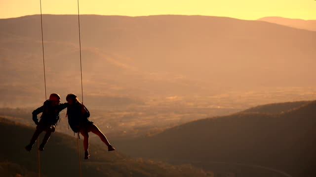 husband and wife on a rope climbing team on the summit - extreme sports stock videos & royalty-free footage