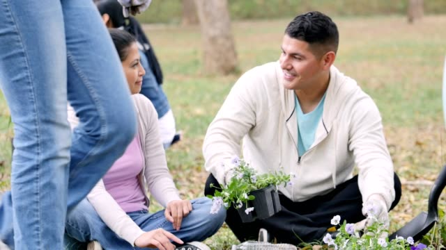 Husband and wife plant flowers during community outreach project