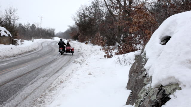 ms husband and wife ridding on motorcycle with sidecar in rural area during winter / osceola, wisconsin, united states - sidecar stock videos & royalty-free footage