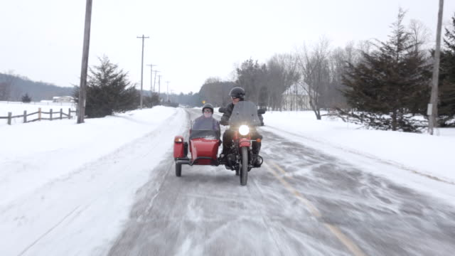 ms  pov husband and wife ridding on motorcycle with sidecar in rural area during winter / osceola, wisconsin, united states - sidecar stock videos & royalty-free footage