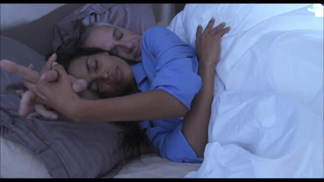 Husband and wife sleeping - Hand in hand