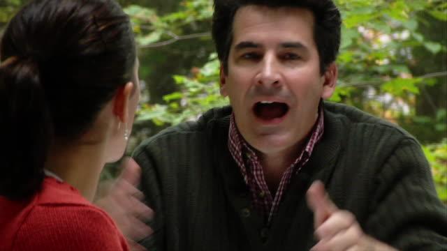 vidéos et rushes de husband arguing with wife / taking sip from mug - quadragénaire