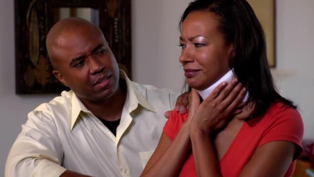 Husband Comforting Injured Wife in Neck brace