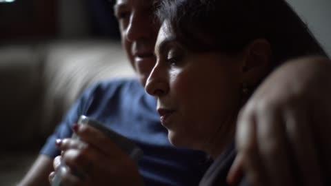 mann umarmt frau mit fieber und trinken ihren tee - illness stock-videos und b-roll-filmmaterial