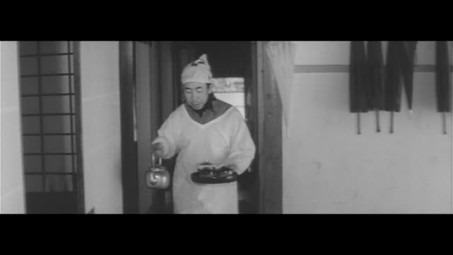 vídeos de stock, filmes e b-roll de husband preparing breakfast handing a towel to wife as she washes her face flower festival dancing young people pouring hot water on a bundle of... - dia do ano novo
