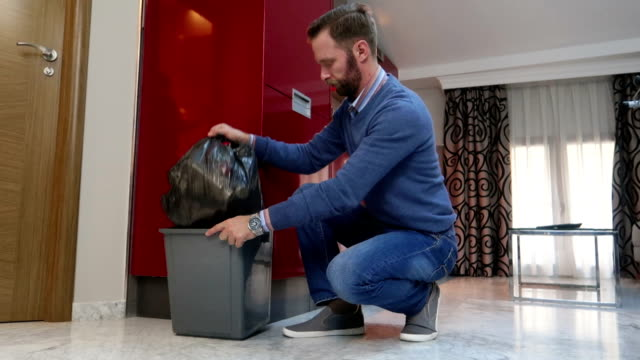 husband taking trash domestic chores - stock video - bin bag stock videos & royalty-free footage