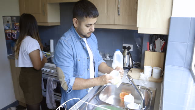 husband washing up - role reversal stock videos & royalty-free footage
