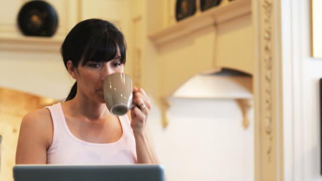 stockvideo's en b-roll-footage met husband with morning breath kissing his wife - een dag uit het leven serie