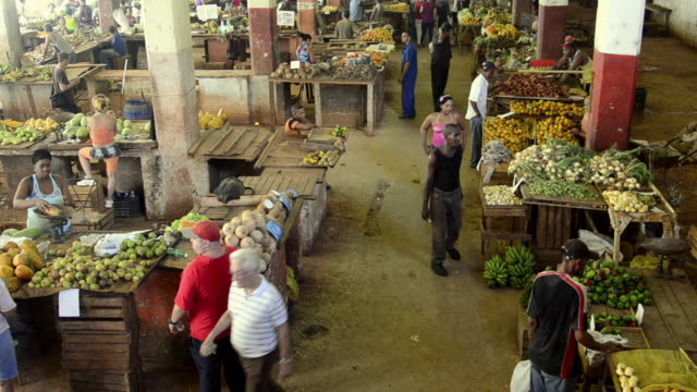 Hustle and bustle of local mercado market in downtown Havana Cuba