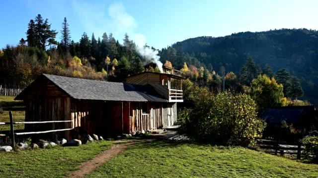 hut and mountain at heshkili hut savaneti, georgia - hut stock videos & royalty-free footage
