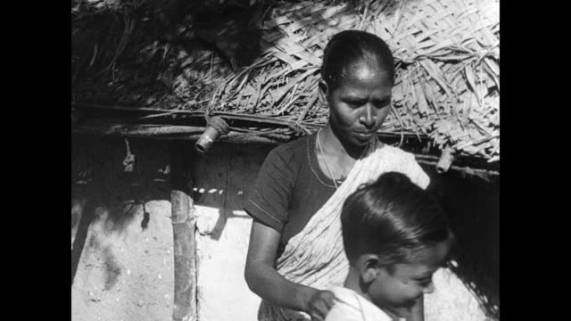 outcasts / untouchables hut home w/ mother and son antony exiting home mother combing boy's hair boy walking to school through town vs public school... - dalit stock videos and b-roll footage