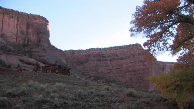 WS Hut in shade near canyon walls/ Canyon de Chelly National Monument, Arizona