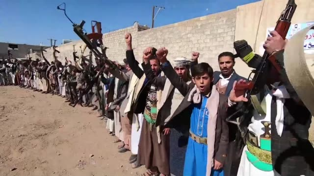 huthi fighters gather in yemen's capital sanaa to react about peace talks taking place in sweden - yemen stock videos & royalty-free footage