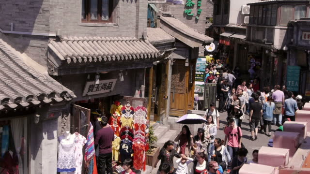hutong, alley, shops, pedestrians, beijing, china - hutong alley stock videos & royalty-free footage
