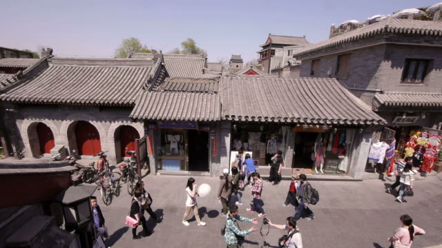 Hutong, alley, shops, rooftops, pedestrians, Beijing, China