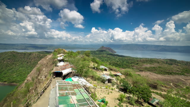 huts on ridge overlooking taal lake - time lapse - batangas province stock videos and b-roll footage