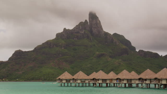 huts on the water - bora bora stock videos and b-roll footage