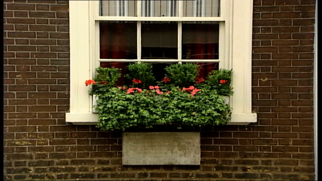 labour mps auction copy of hutton report at mayfair club mayfair dover street arts club ext general view of arts club building zoom in window box of... - window box stock videos and b-roll footage