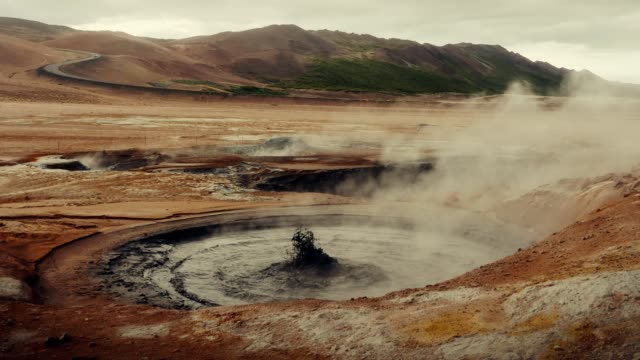 hverarond geothermal area. hissing steam vents - geyser stock videos & royalty-free footage