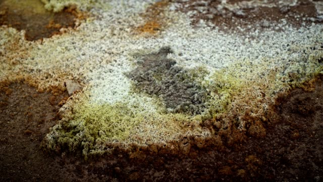 hverarond geothermal area. multi colored sulphur rocks - sulphur stock videos & royalty-free footage