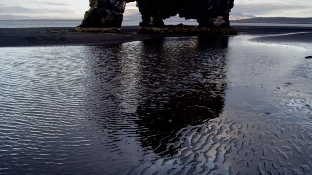 hvitserkur - iconic sea stack on volcanic black beach - stack rock stock videos and b-roll footage