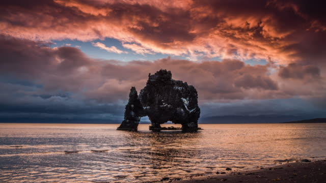hvítserkur rock formation in iceland - natural arch stock videos & royalty-free footage